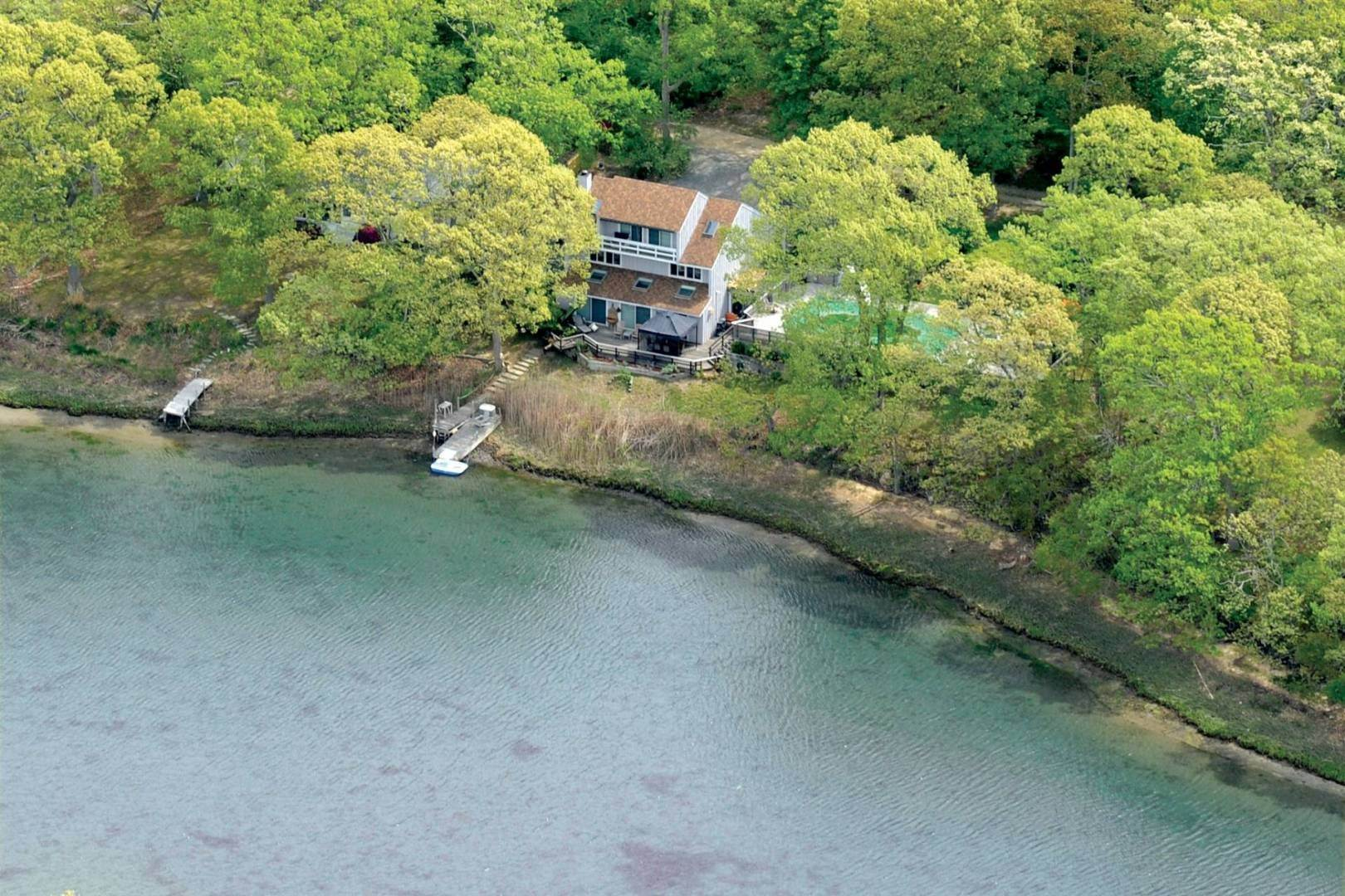 35. Single Family Home at Modernist Waterfront With Pool Near Shelter Island Heights Shelter Island Heights, NY 11965