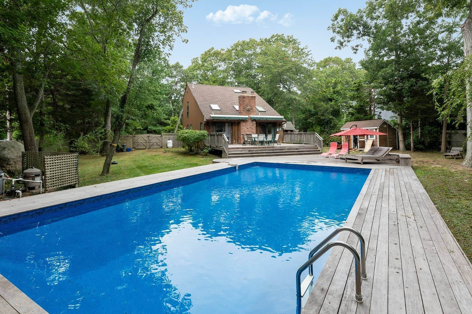 Single Family Home at Charming Home With Heated Pool 221 Norfolk Dr, East Hampton, NY 11937