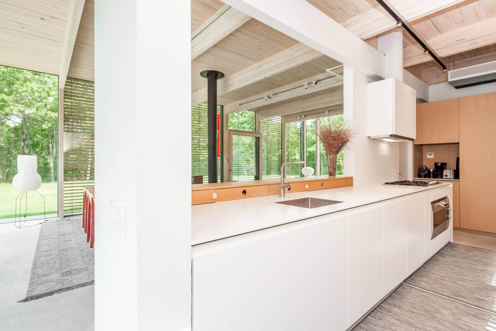 8. Single Family Home at Modern Glass House With Grace, Style And Warmth 184 Red Dirt Road, East Hampton, NY 11937