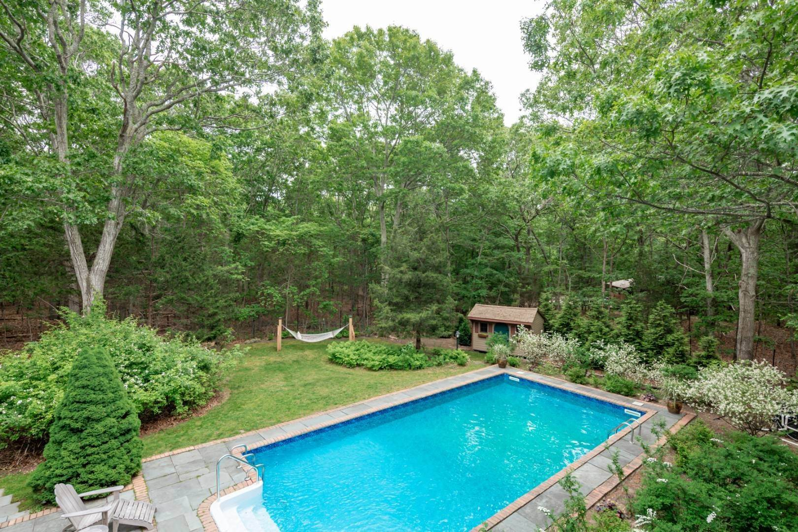 20. Single Family Home at Pristine Contemporary With Heated Pool On A Private Acre East Hampton, NY 11937