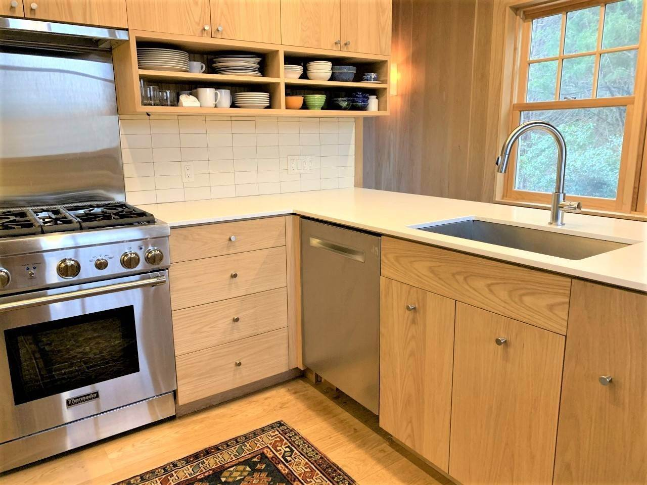 6. Single Family Home at Fun Carefree Village Renovated Modern Interior And Heated Pool Sag Harbor, NY 11963