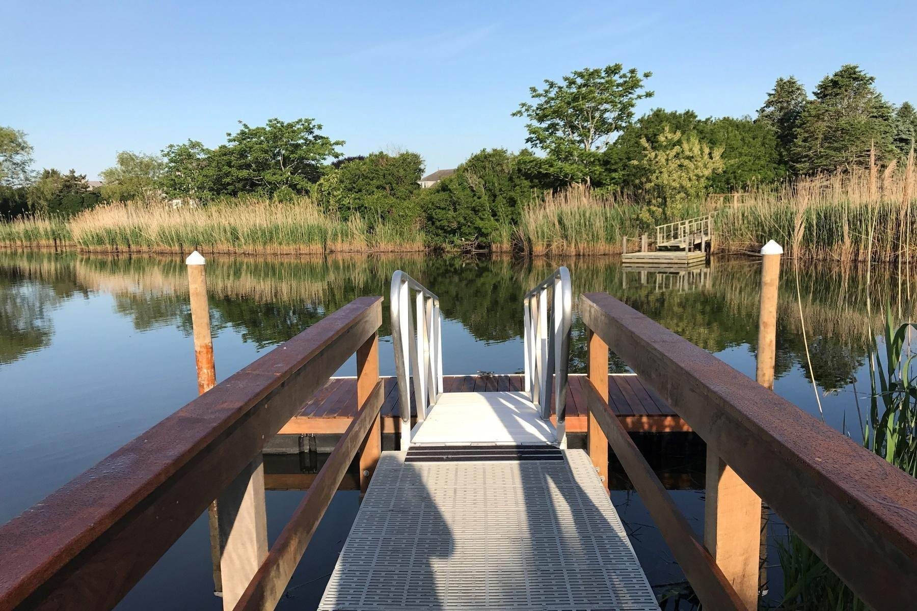 13. Single Family Home at Close To Ocean With A Dock On Sam's Creek Bridgehampton, NY 11932