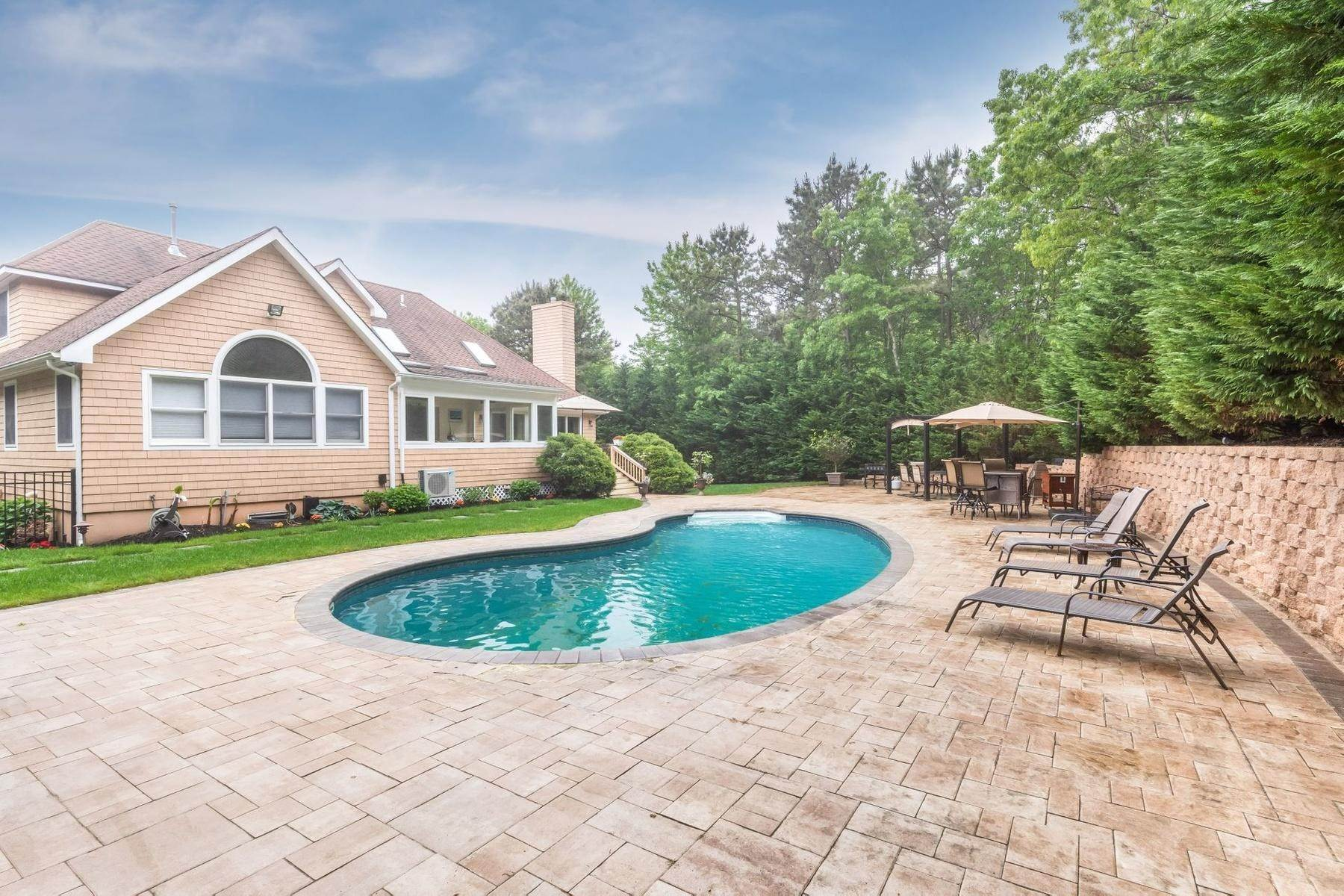 3. Single Family Home at Upscale Home In The Pines With Inground Heated Pool East Quogue, NY 11942
