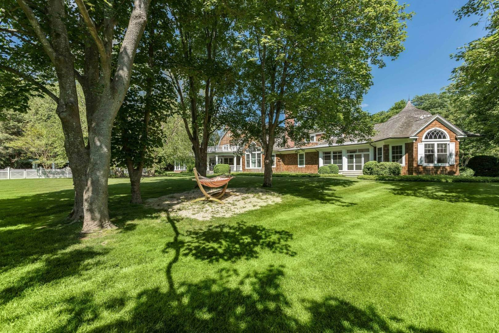 Single Family Home at Beautifully Positioned 11,600 Square Foot Traditional 47 Georgica Road, East Hampton, NY 11937