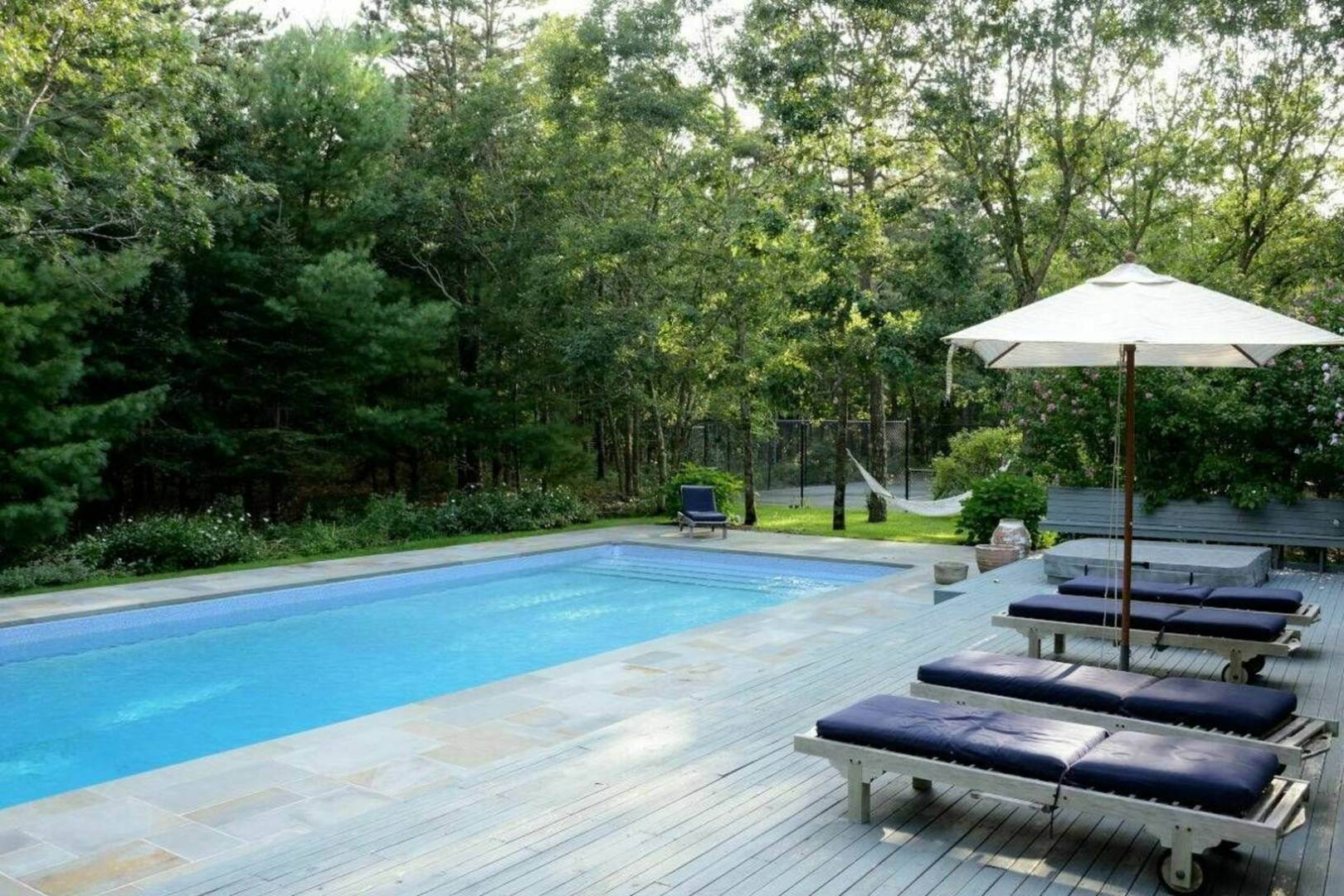 1. Single Family Home at Wainscott North Contemporary With Privacy Wainscott, NY 11975