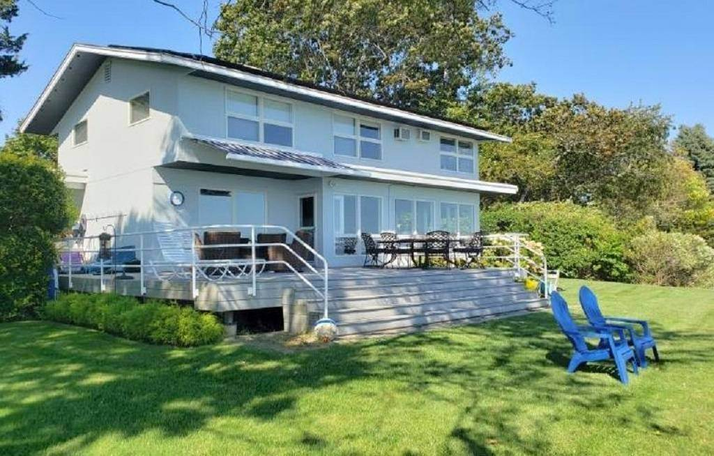 Single Family Home at Stunning Right On The Beach Modern Beauty! $7,900 Sept To April 11 Beach Road, Jamesport, NY 11947
